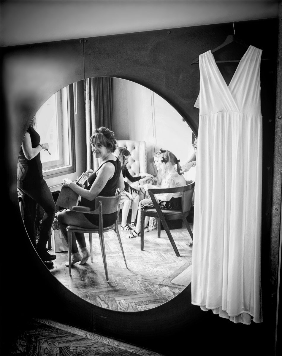 Bride in mirror at East London wedding hotel