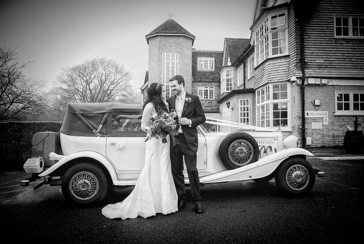 Couple and wedding car at Grovefield House wedding
