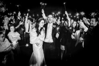 Fun with sparklers photo at London wedding