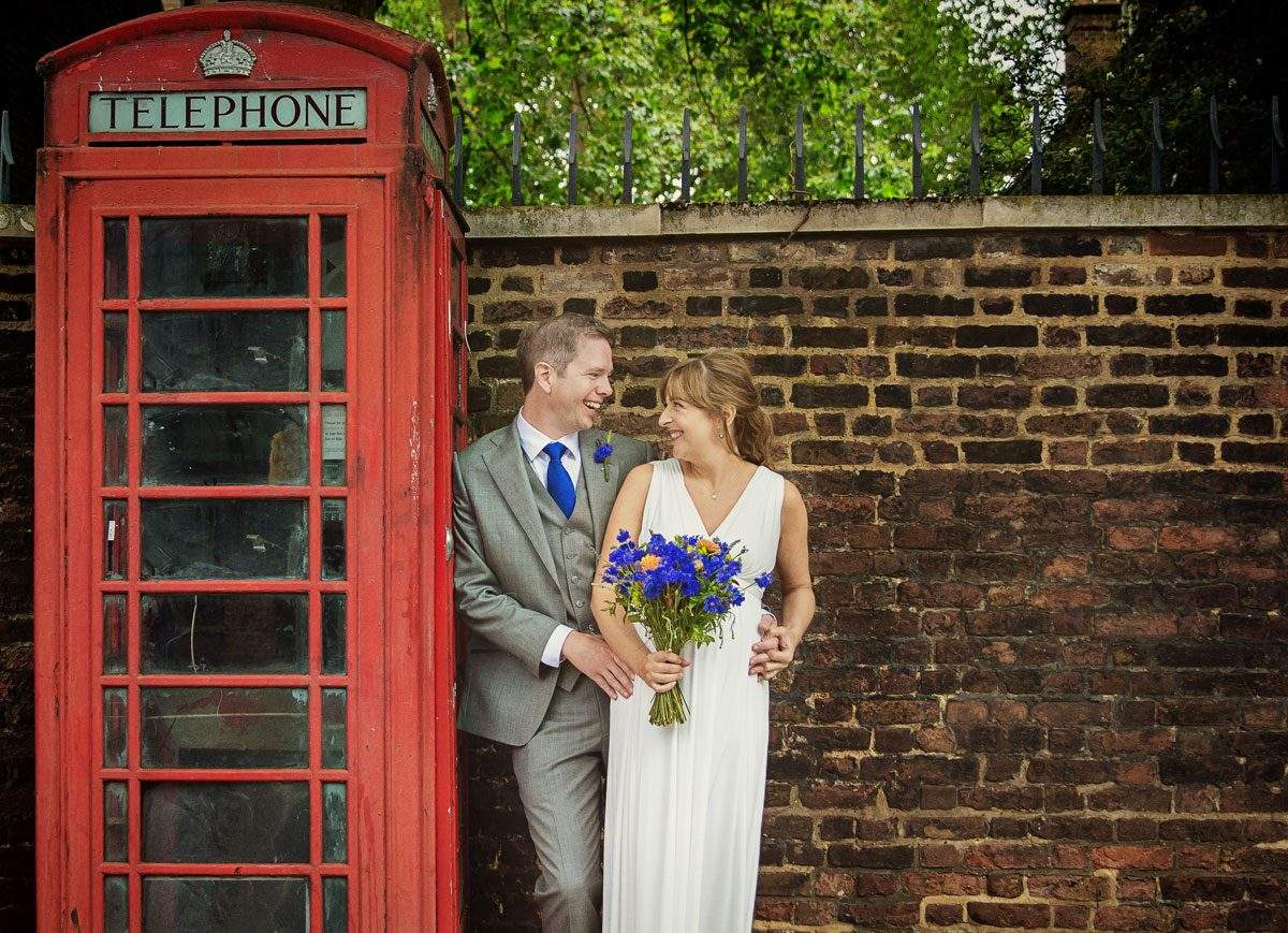 Shoreditch wedding couple by red London phone box photo