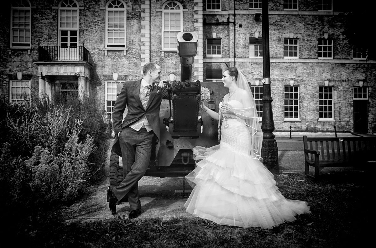 Wedding couple pose by gun at HAC Armoury House wedding