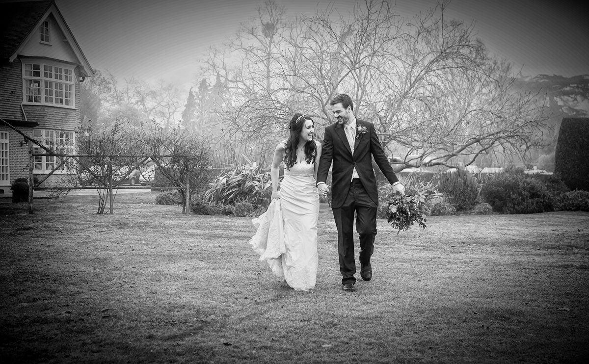 Wedding couple walking at Grovefield House Windsor