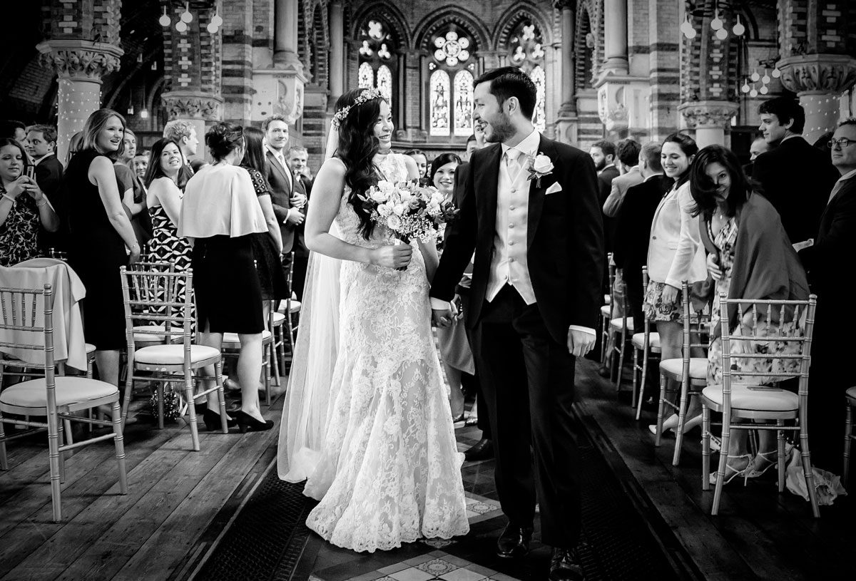 Bride-and-groom-walk-down-the-aisle-at-London-Hampstead-wedding