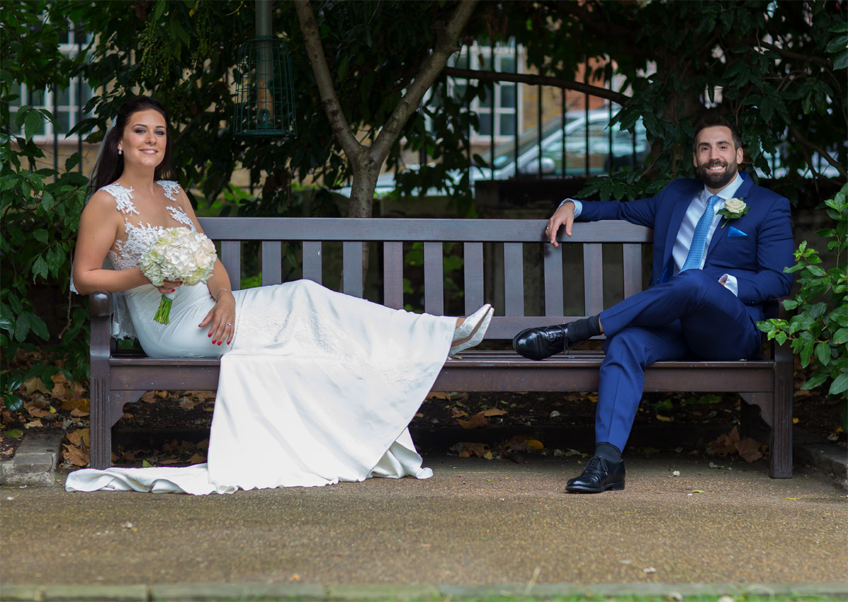 Chelsea Old Town Hall wedding bride and groom on a bench photo