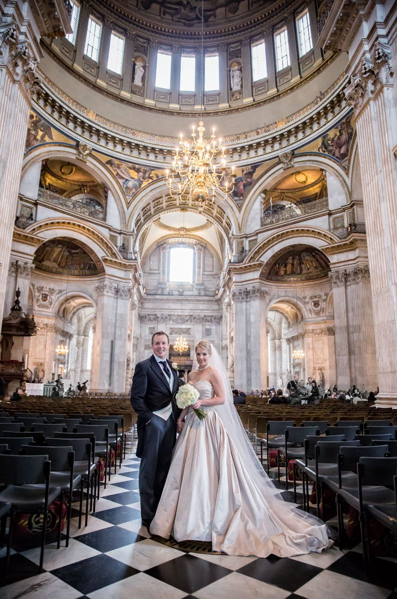 Wedding-couple-pose-after-ceremony-at-St-Pauls-Cathedral-wedding