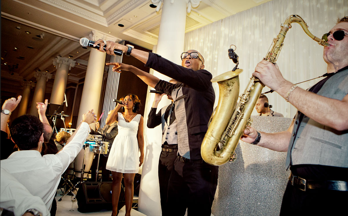 Band plays at wedding reception Waldorf Hilton London