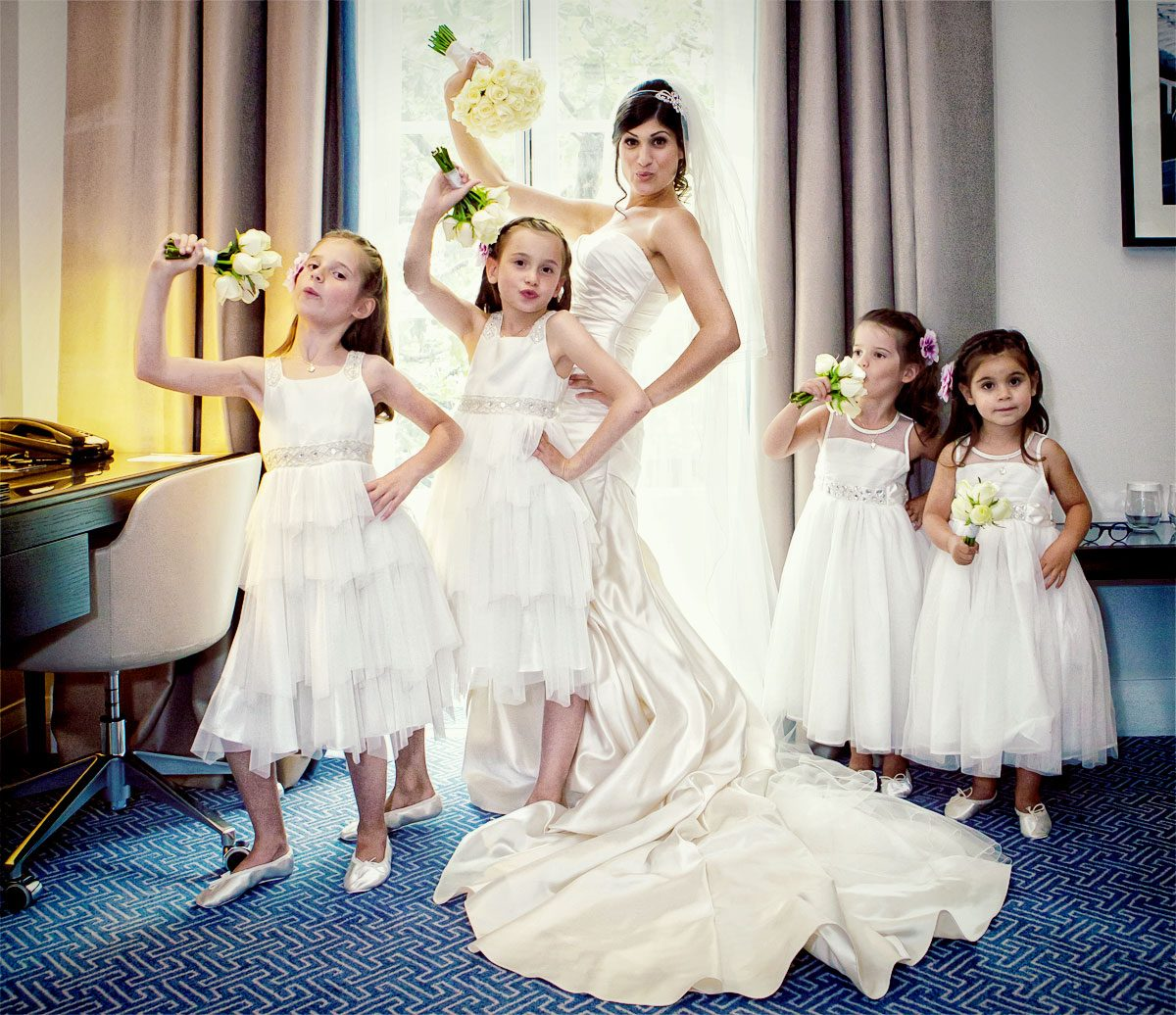 Bride and flower girls pose at Waldorf Hilton Hotel wedding