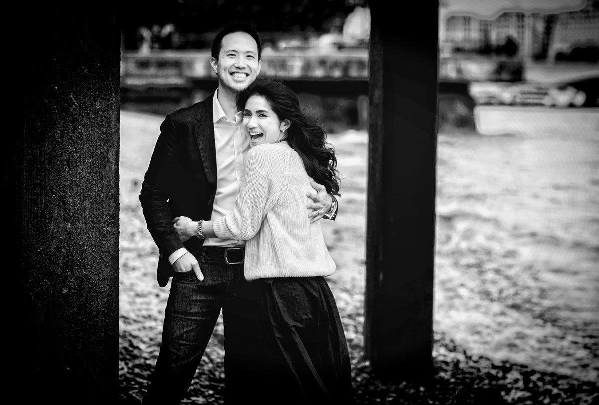 Couple laugh on beach for London Southbank engagement shoot