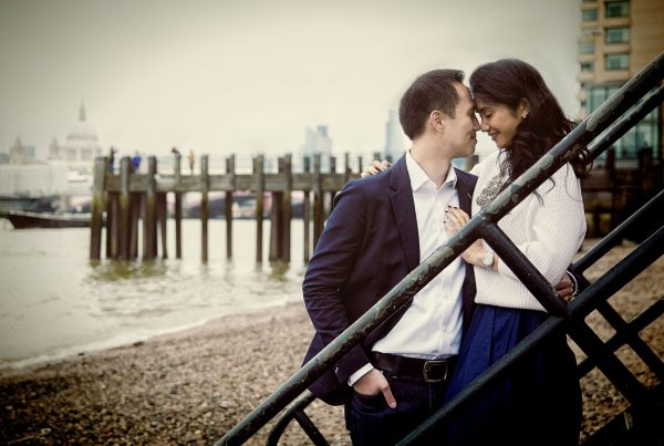 Couple on beach by Oxo Tower engagement photo shoot