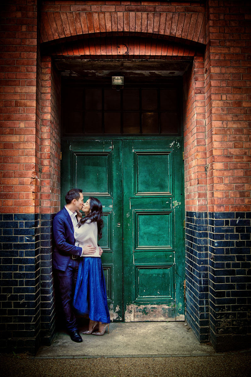 Engagement couple kiss in doorway London Southbank