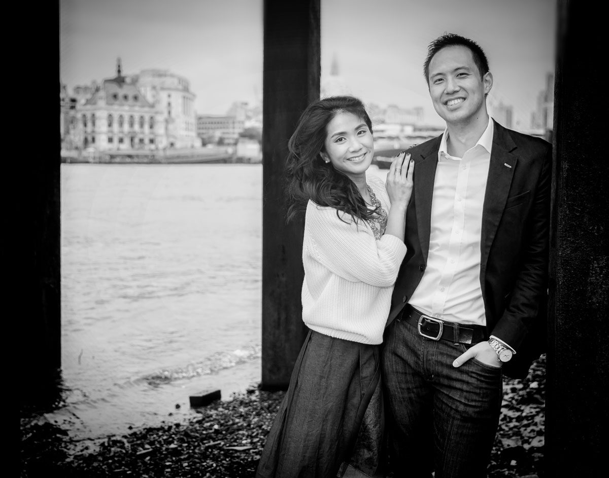 Engagement couple on beach by Oxo Tower at London Southbank photo