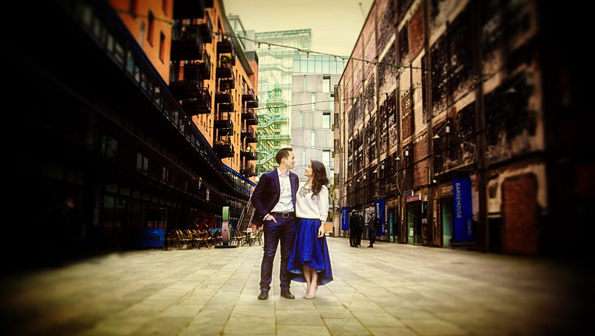 Engagement couple stood behind Oxo Tower London
