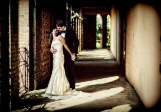Jewish wedding couple laugh in Hampstead pergola