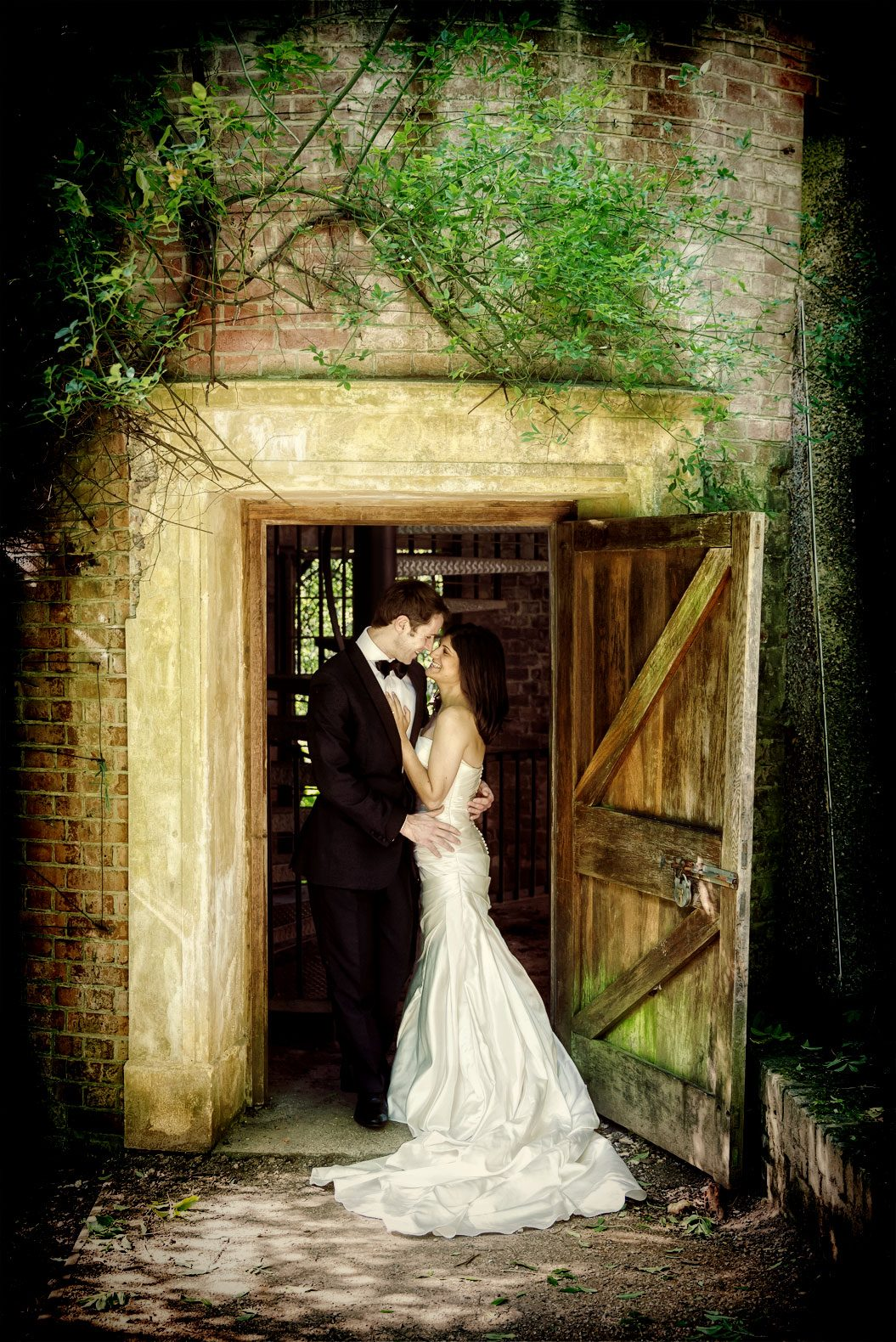 Wedding couple kiss in a doorway on their central London wedding