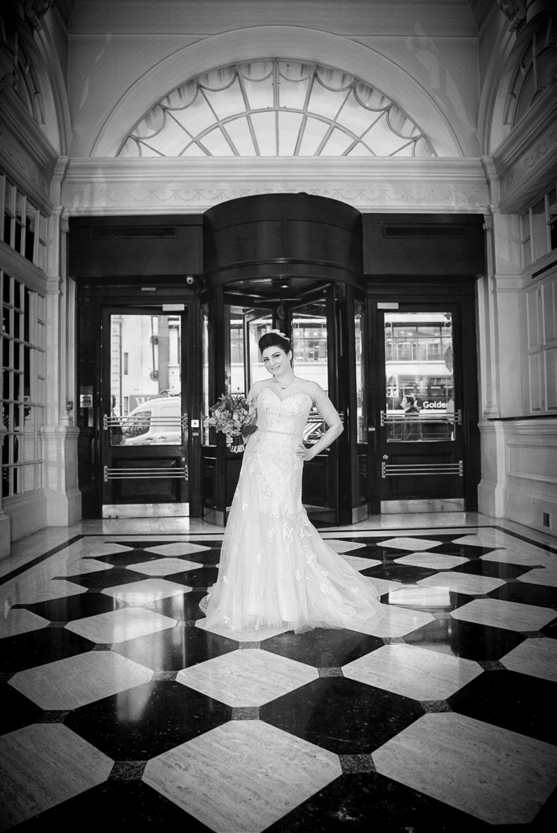 Bride in reception at Le Meridien Hotel London wedding
