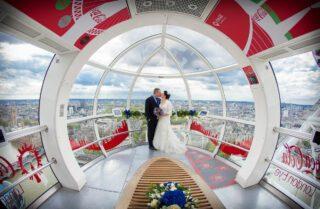 London Eye wedding photographers coca cola kiss photo
