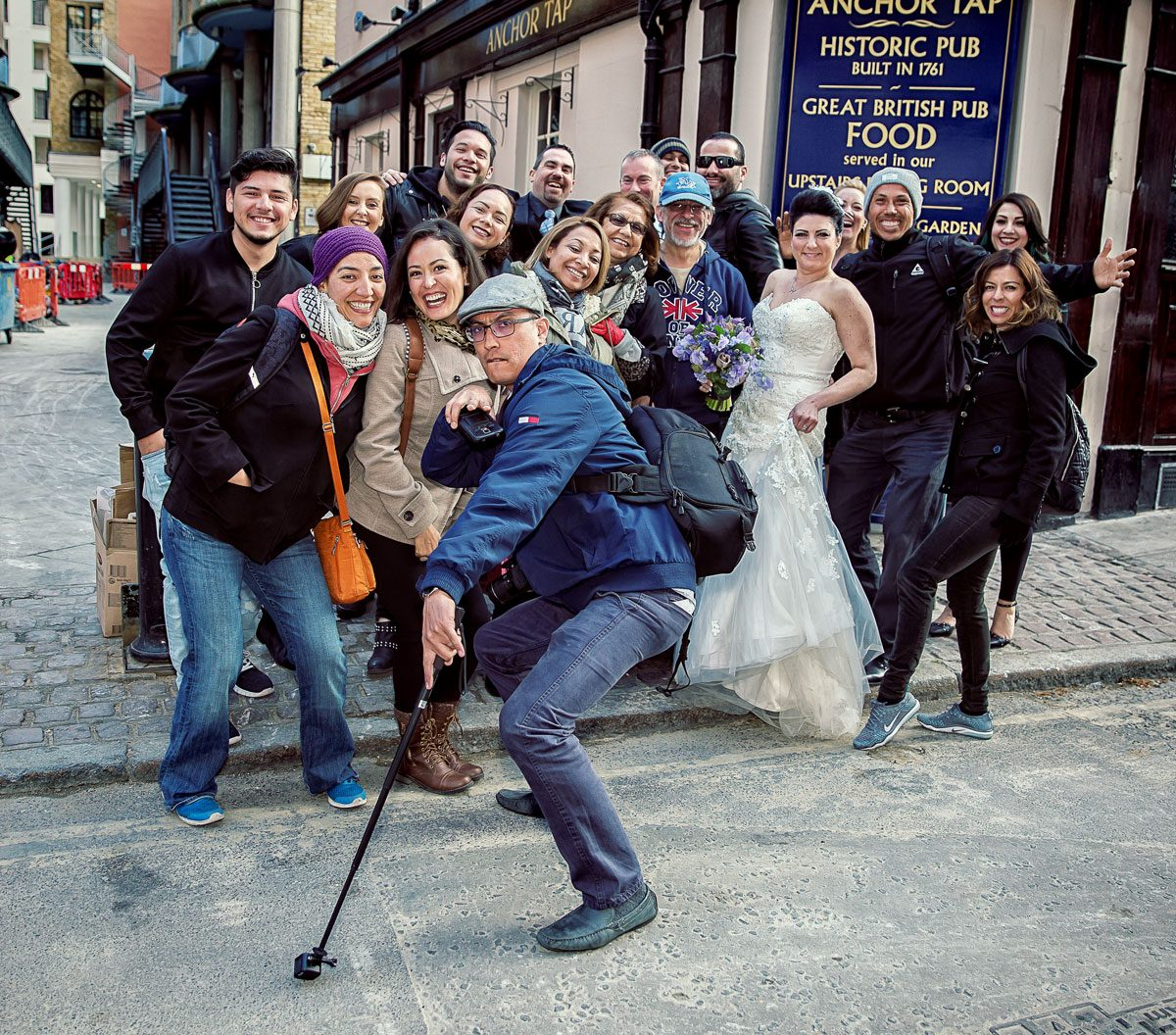 London wedding couple pose with tourists at Butlers Wharf photo