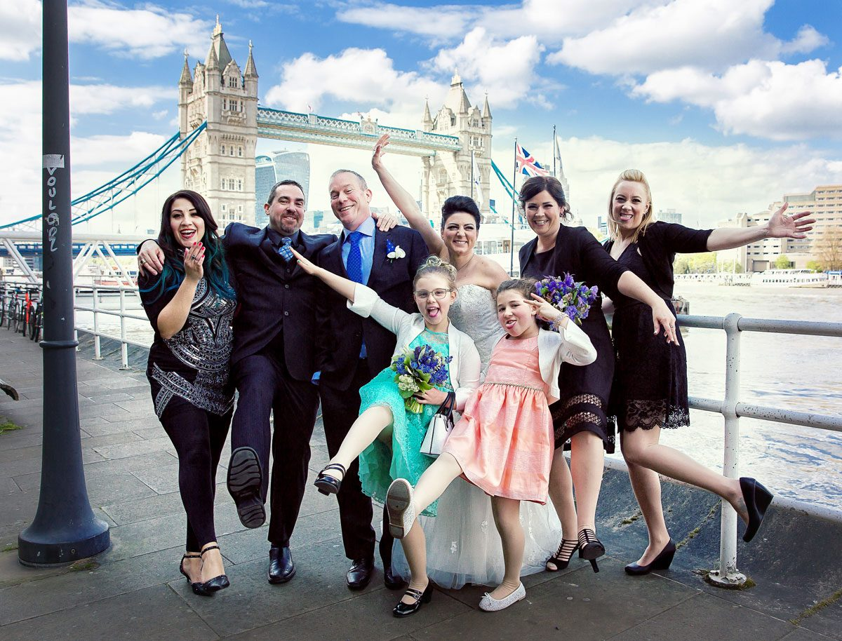 London-wedding-party-pose-by-Tower-Bridge-at-Butlers-Wharf