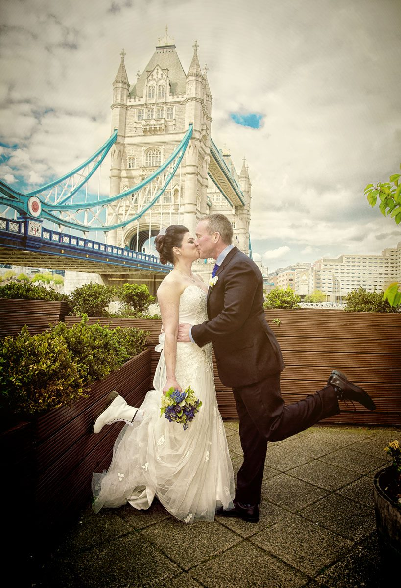 Wedding couple kiss by Tower Bridge London