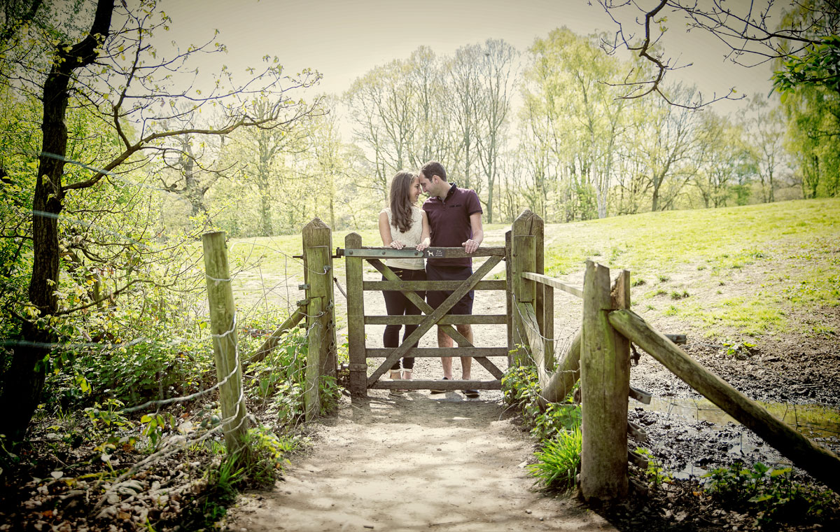Wedding couple on Hampstead Heath stare into each others eyes photo