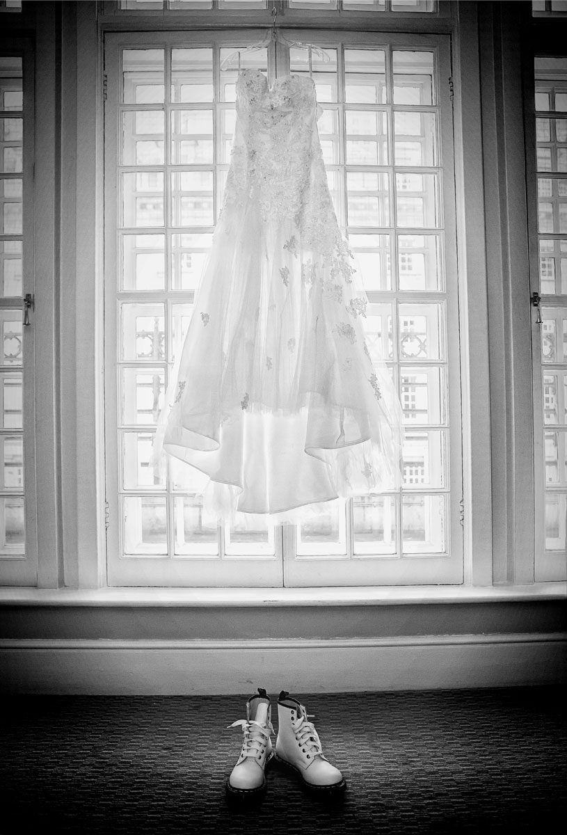 Wedding dress and shoes hanging at Le Meridien Piccadilly London