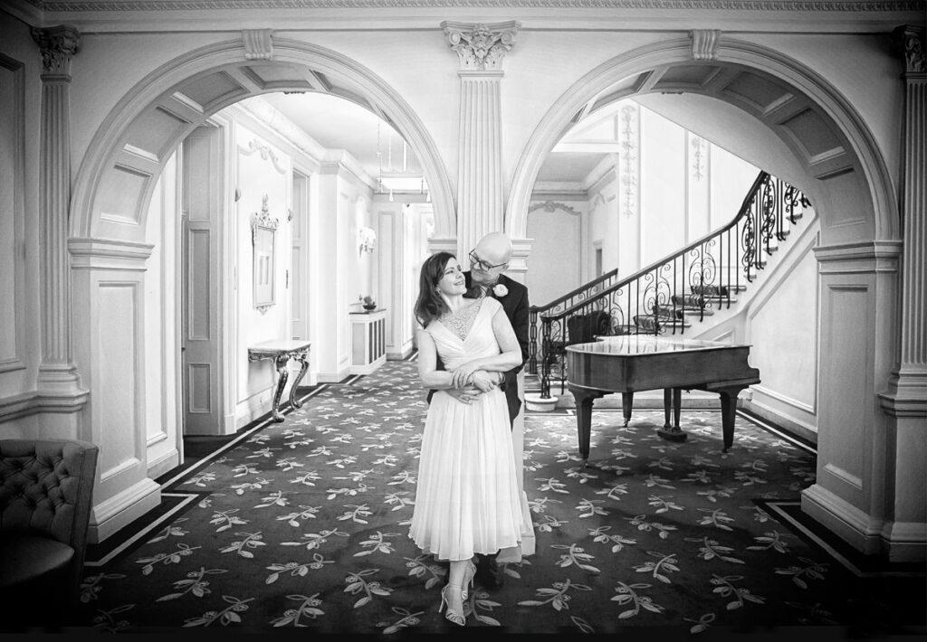 Claridges Hotel wedding photographers couple photo between arches