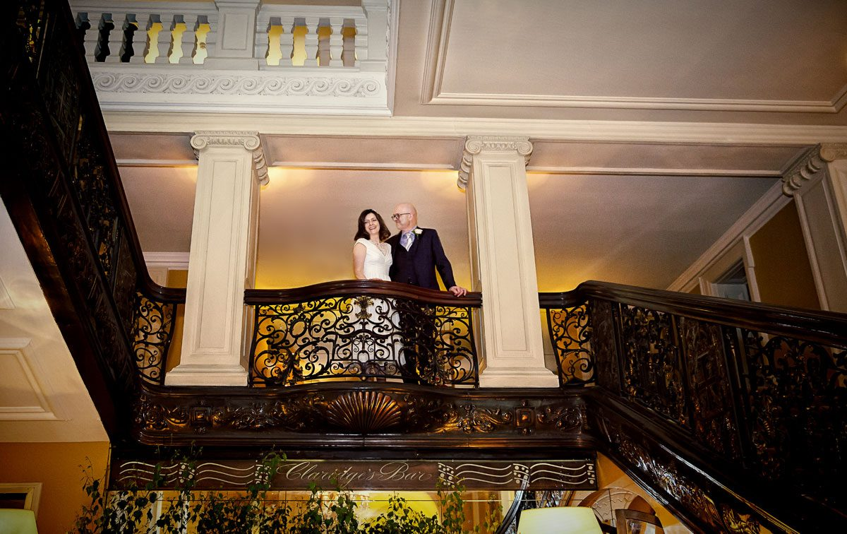 Claridges wedding bride and groom on the balcony photo