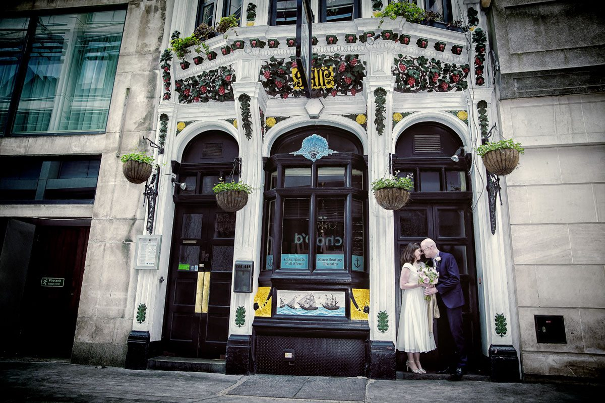 Wedding couple in pub doorway central London