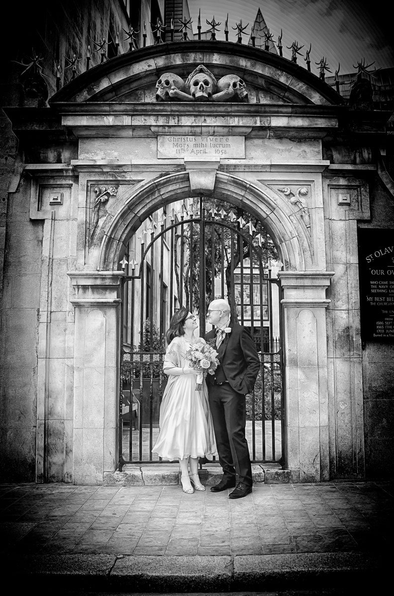 Wedding couple at the gates of St Olave Hart Street London