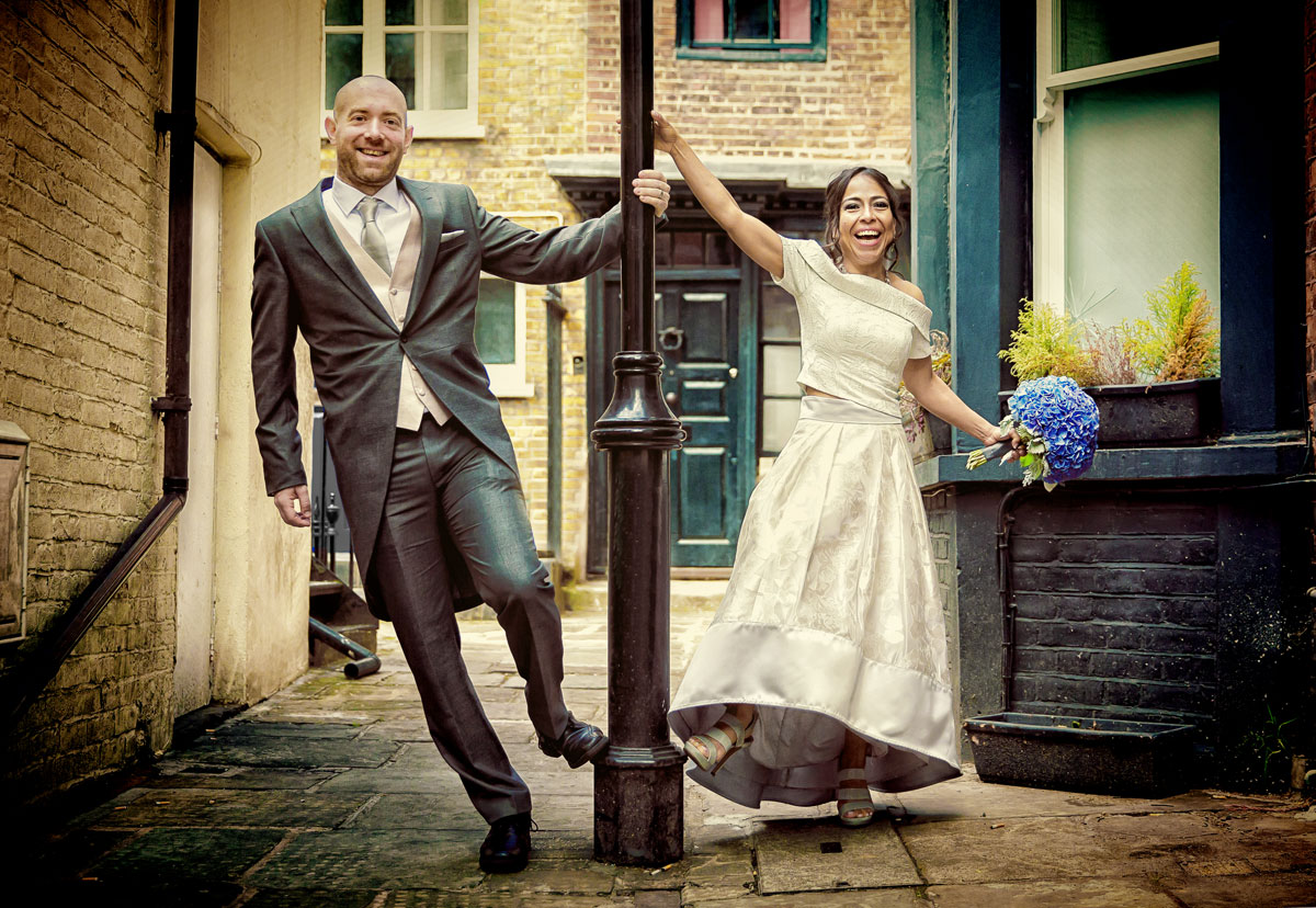 Couple hold lamp post after Islington Town Hall Wedding image
