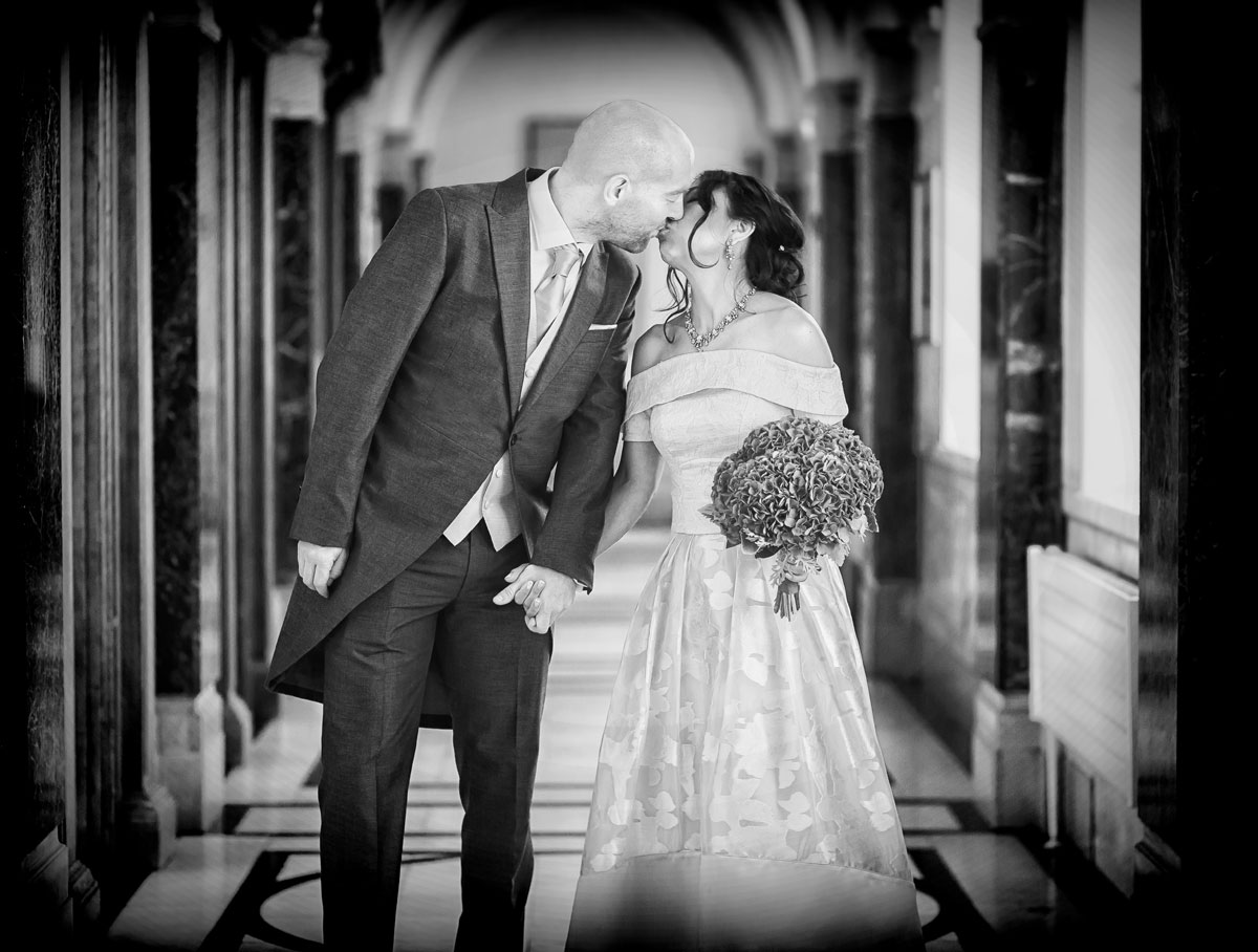 Couple kiss in corridor at their Islington Town Hall wedding