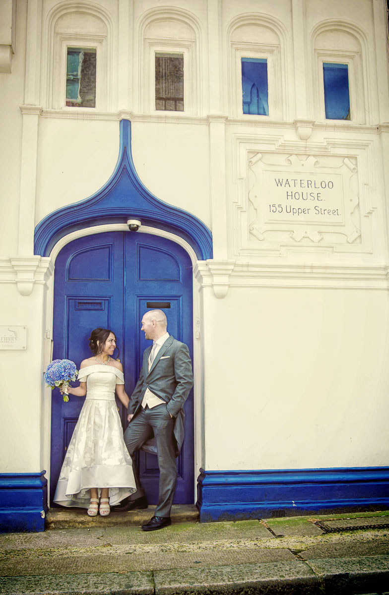 Islington wedding couple by blue door Upper Street