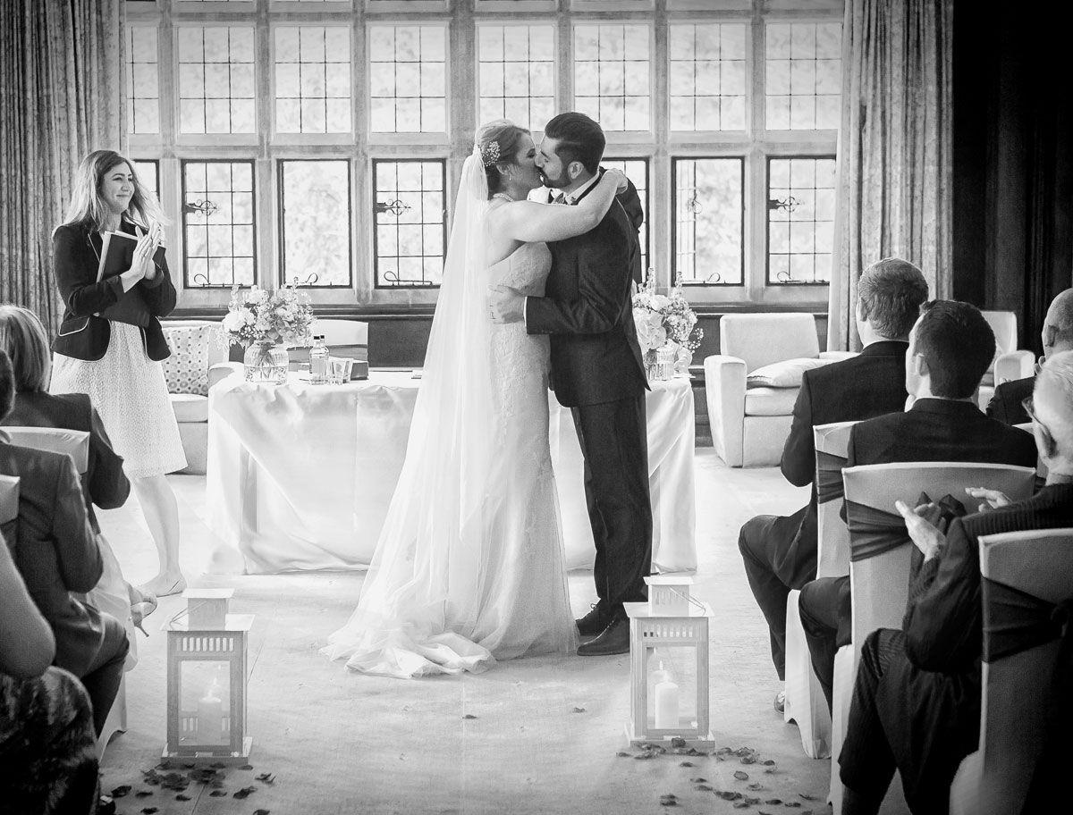 Wedding kiss at Fanhams Hall Ware Hertfordshire