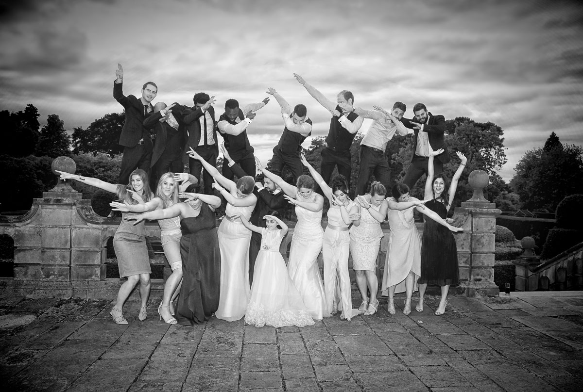 Wedding party group shot do mass dab at Fanhams Hall ware