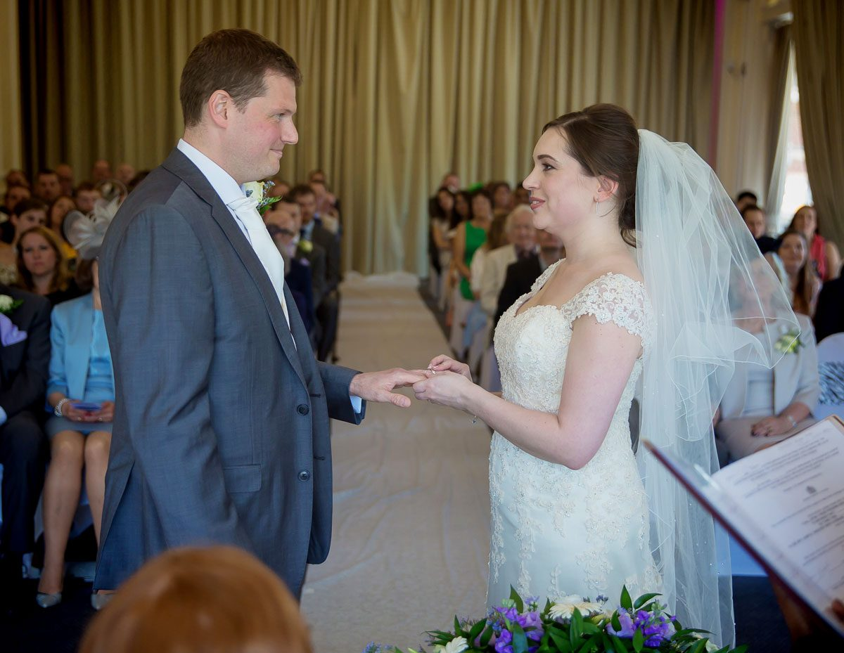 Exchange of rings at London Zoo wedding