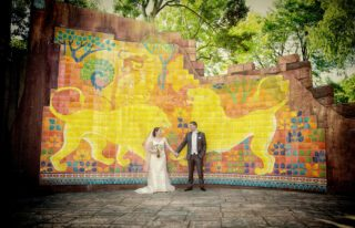 London Zoo wedding bride and groom in front of jungle mural