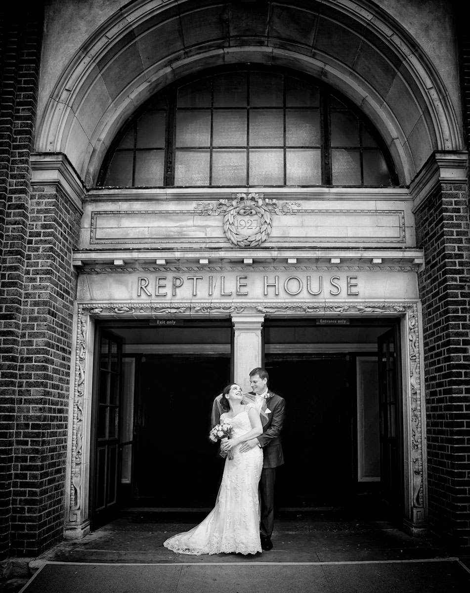 London Zoo wedding photographers couple outside Reptile House image