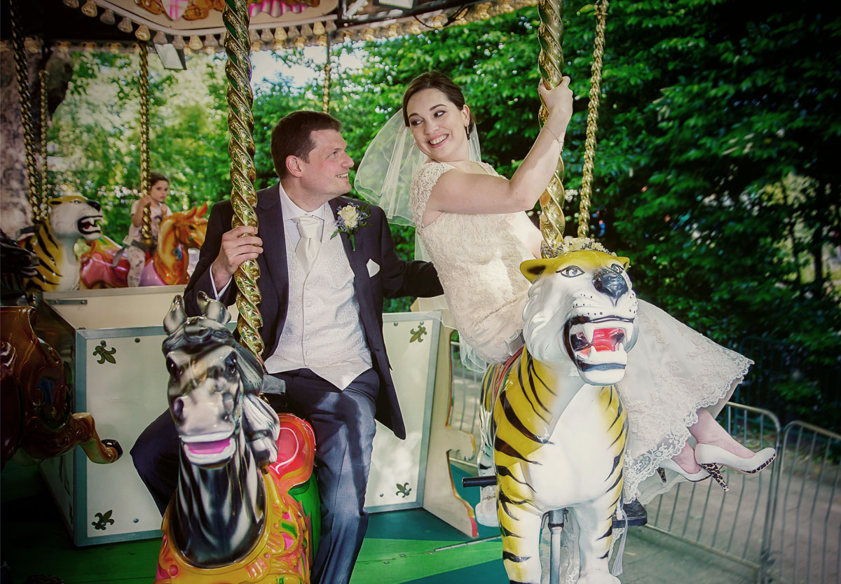 Wedding couple on carousel at London Zoo