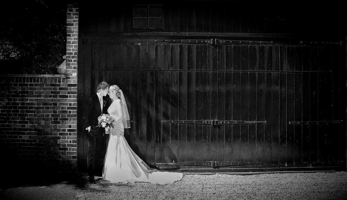 Barnet wedding couple in front of London stable doors