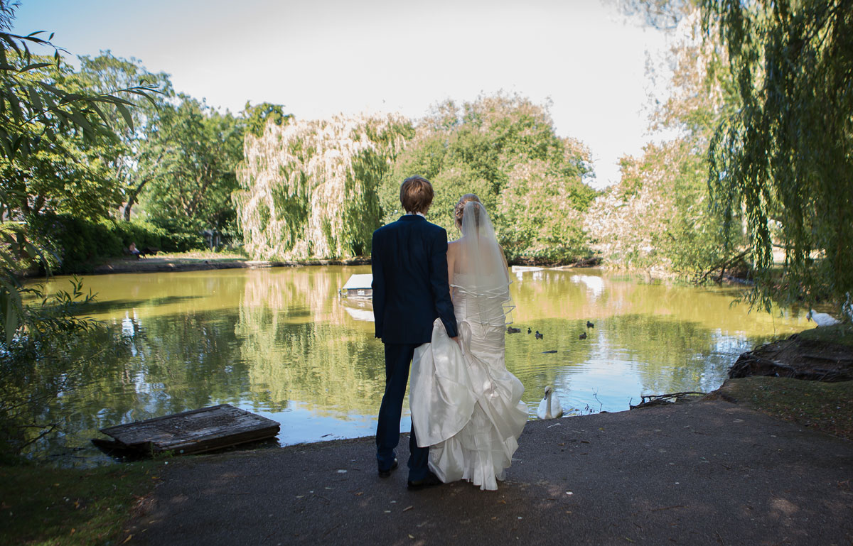 Barnet wedding couple look across lake image