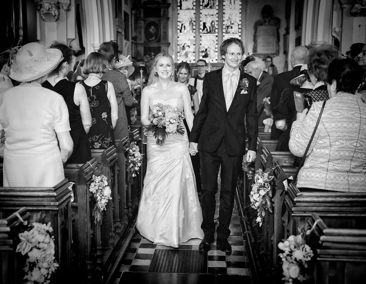 Bride and groom church recessional at Barnet wedding