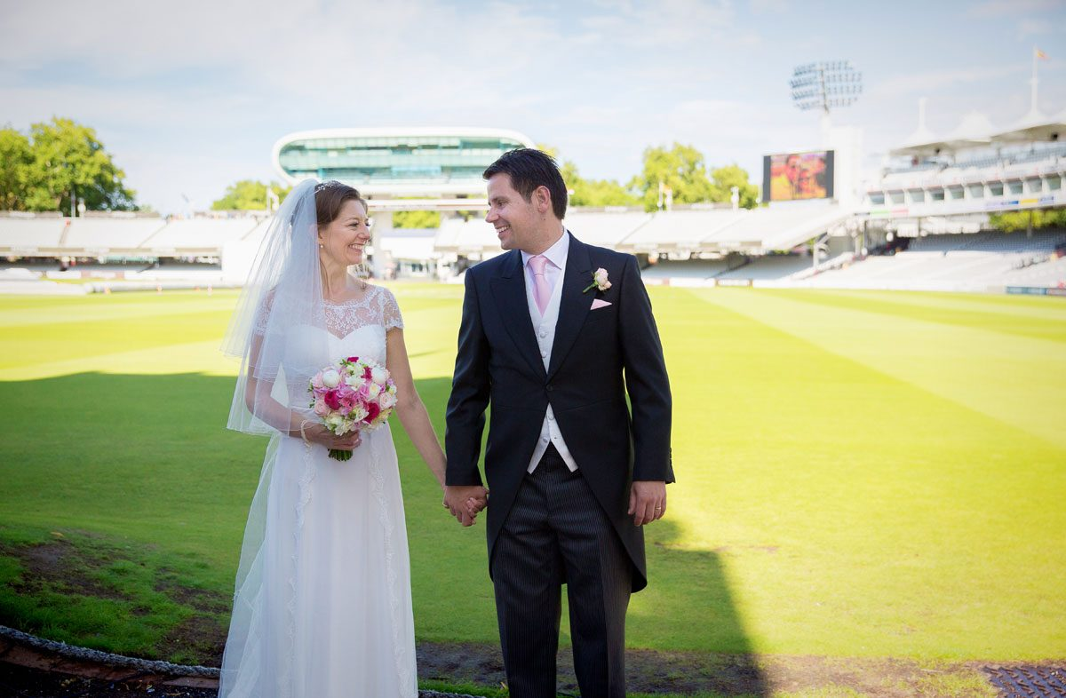 Bride and groom pitch side at Lords Cricket Ground wedding image