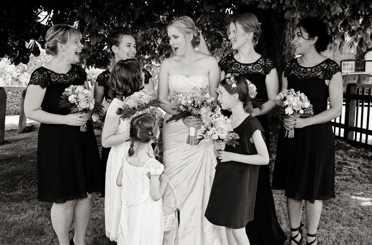 Bridesmaids laugh together at Barnet Church wedding
