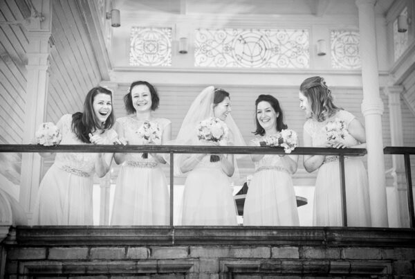 Bridesmaids laughing at Lords Cricket Ground wedding
