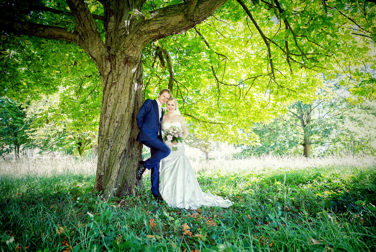 Couple pose under tree after Barnet wedding