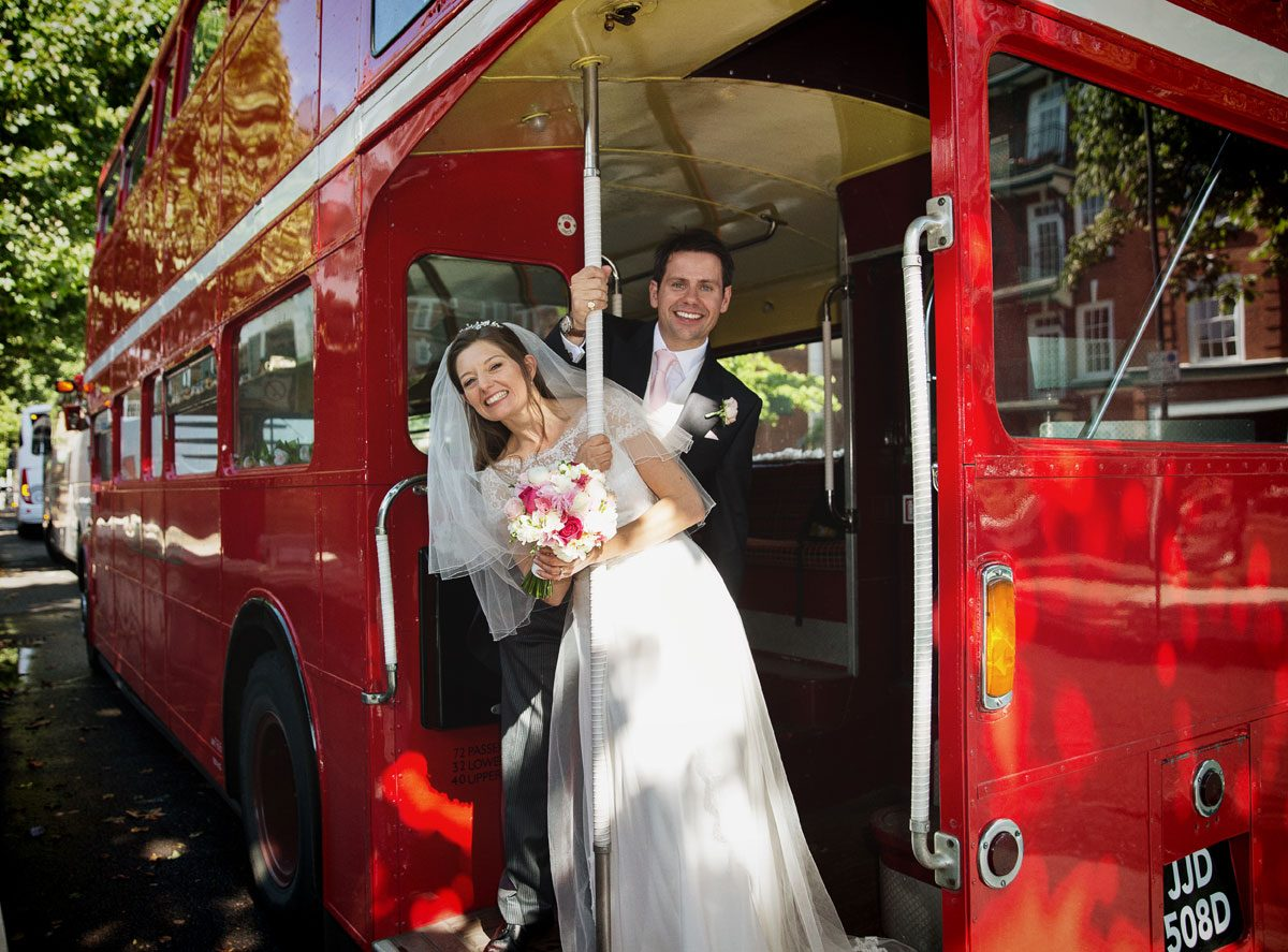 London wedding couple on routemaster bus at Lords Cricket Ground