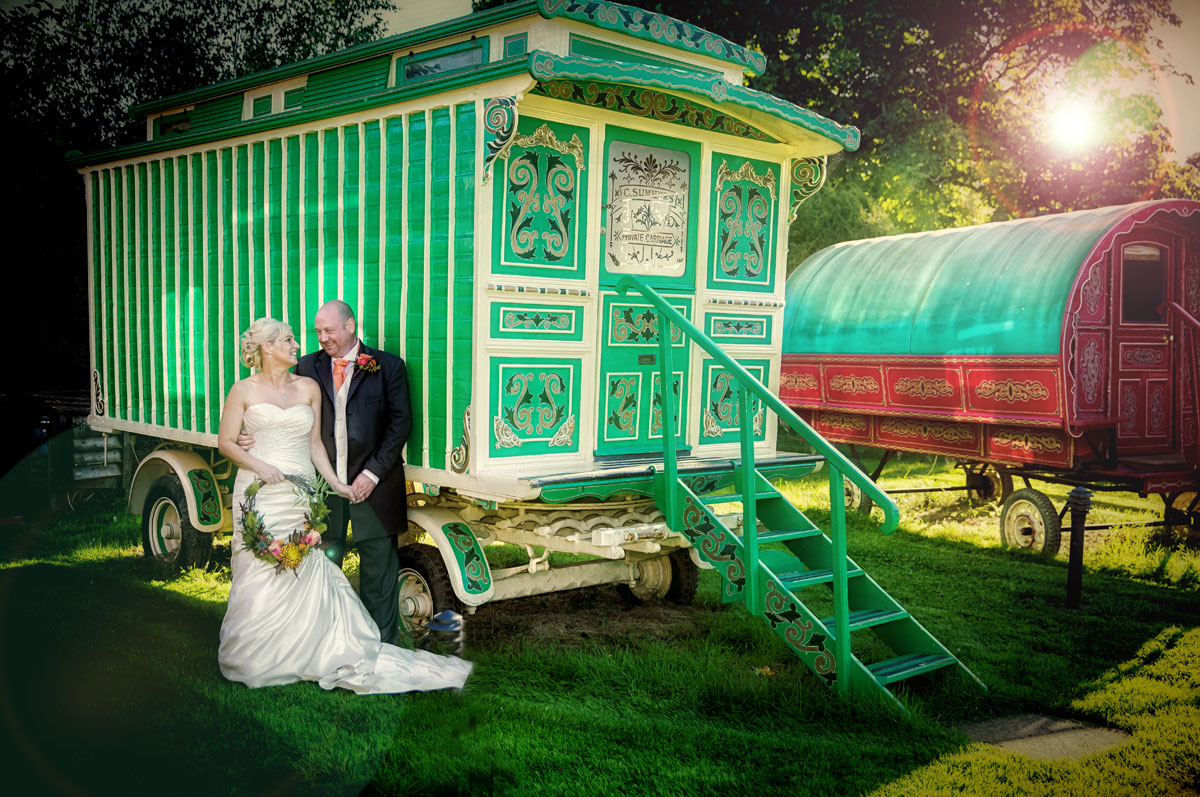 Bride and groom by caravan at their South Farm wedding