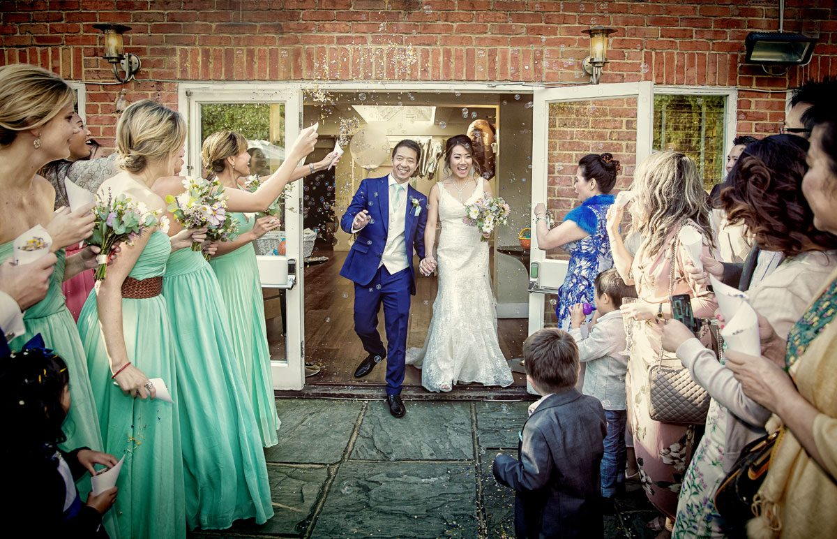 Confetti and bubbles at Stoke Place wedding day