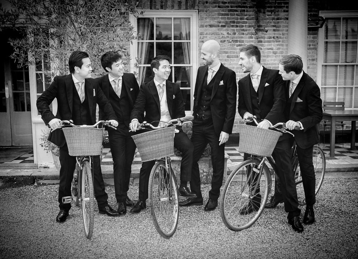 Groomsmen on bicycles at Stoke Place Hotel wedding morning