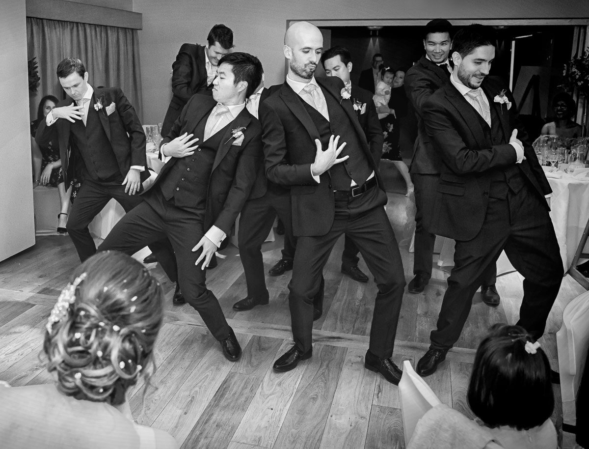 Groomsmen dance at Stokes Place Hotel wedding reception